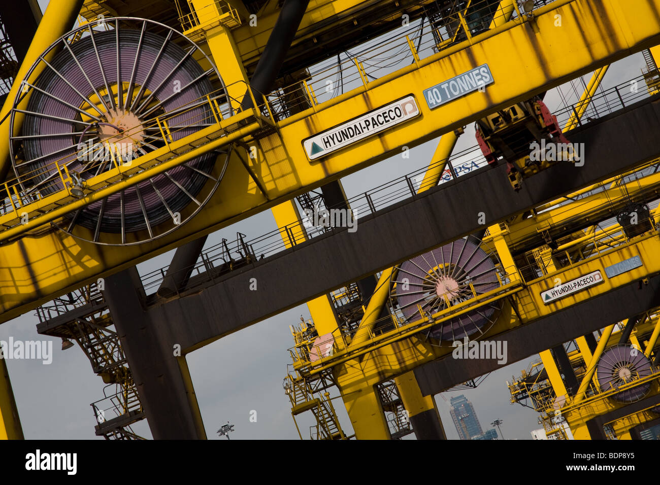 Container port crane spool cable cabling cranes - Stock Image