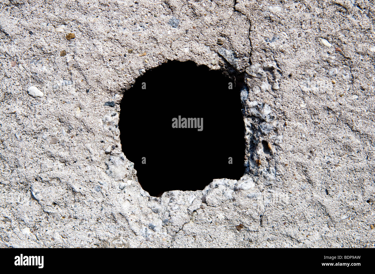 Old concrete wall with hole - Stock Image