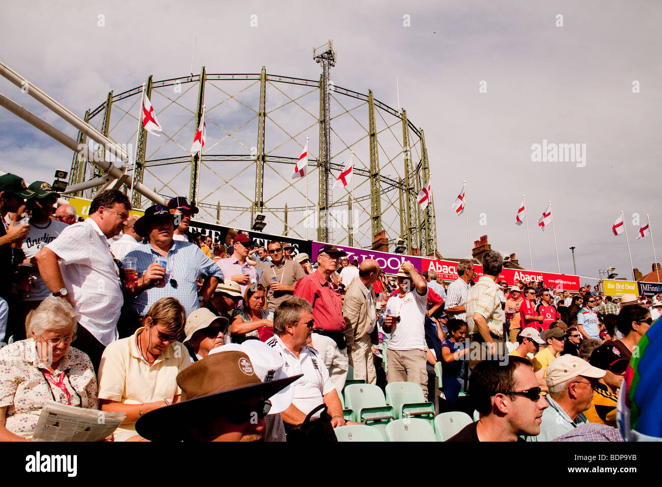 Crowd watching cricket game in front of a gas holder, London, UK The Oval - Stock Image