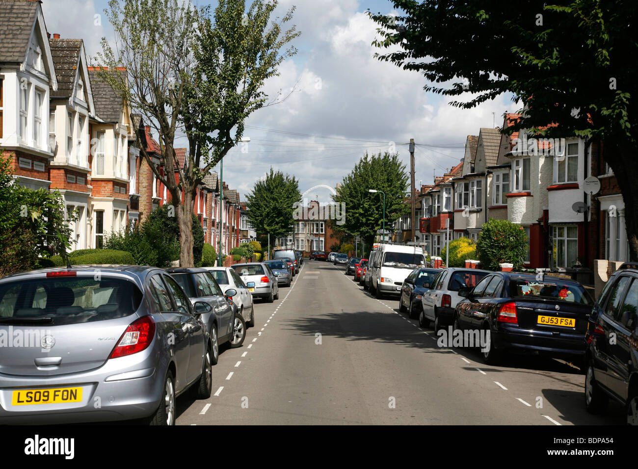 Looking down Harlesden Gardens to a distant Wembley Arch, Harlesden, London, UK - Stock Image