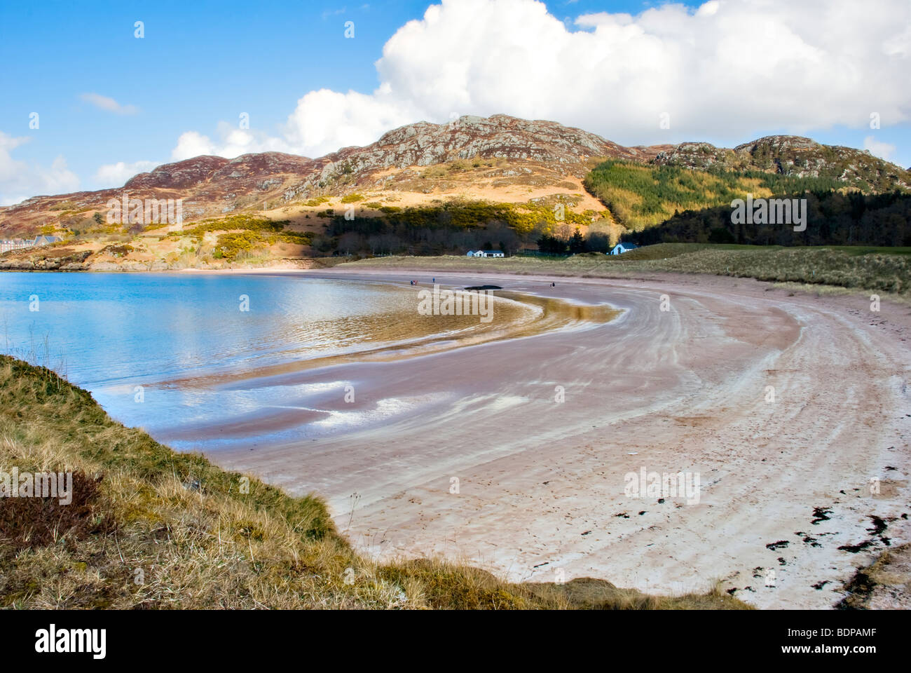 Sandy beach and bay at Gairloch, Wester Ross, Scotland on a bright sunny, spring day with blue sky  and sea - Stock Image