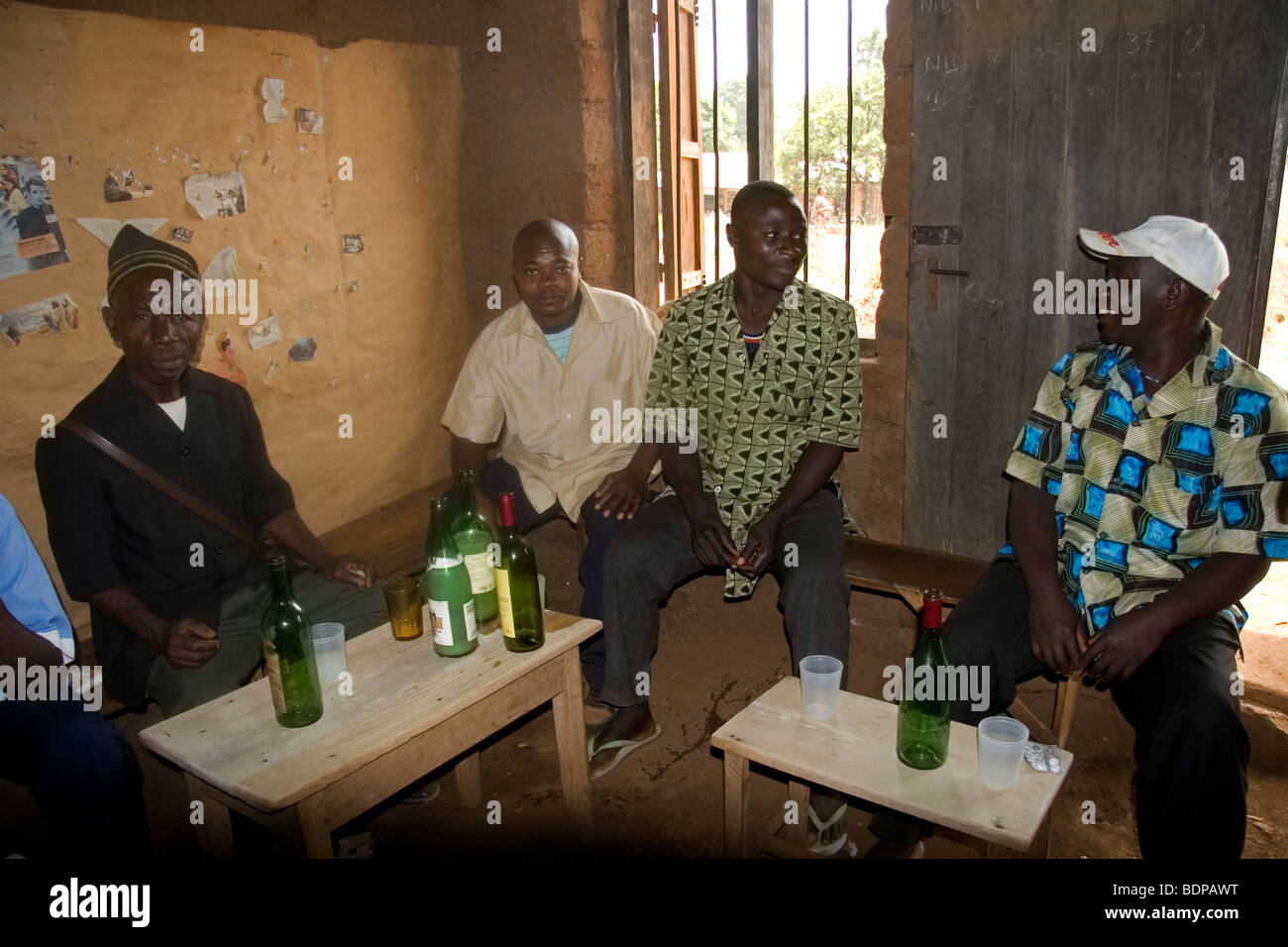 Men drinking home-made palm wine in palm wine tavern Bamessing village Bamenda Highlands Cameroon - Stock Image