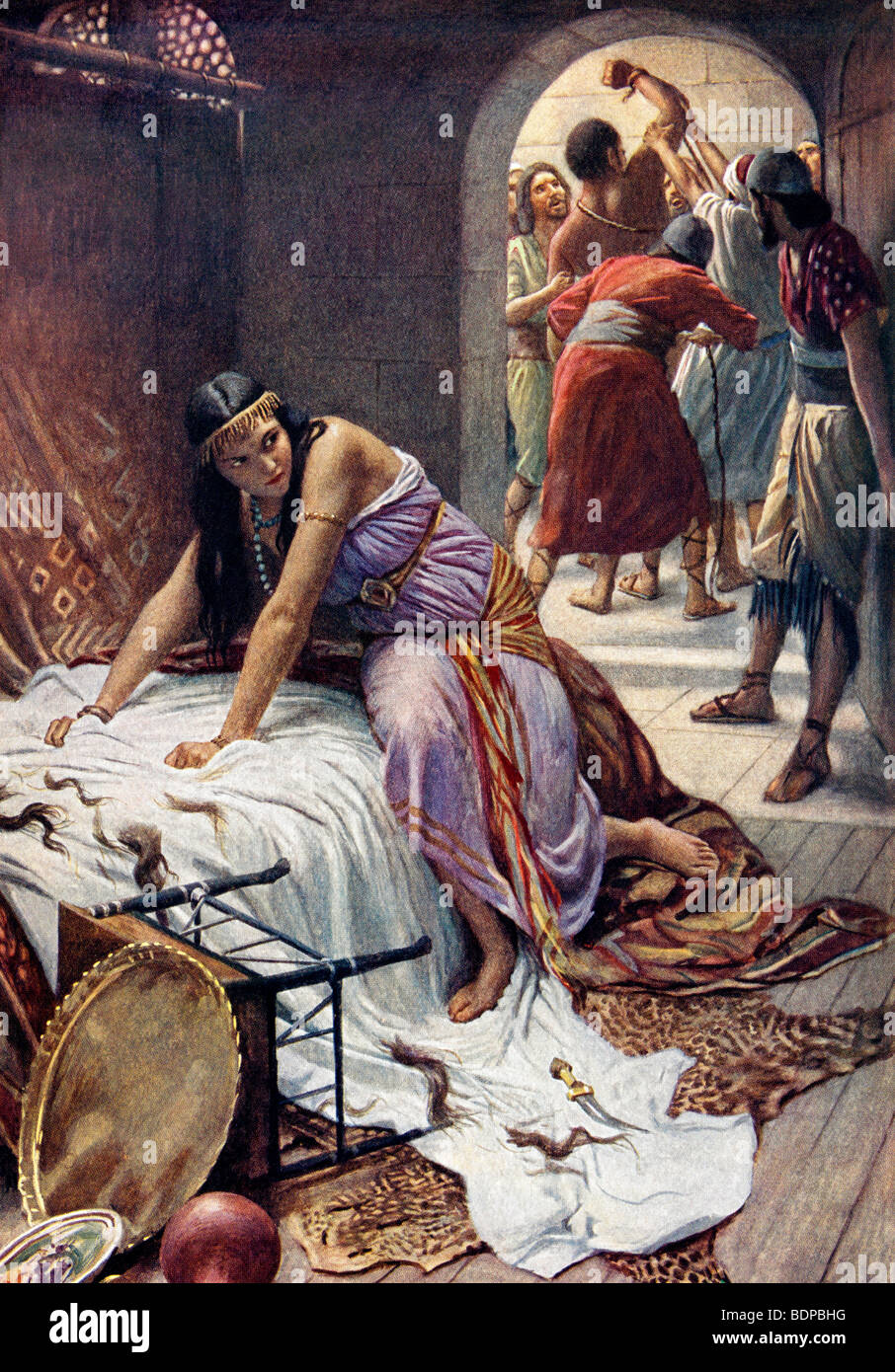 Painting of Delilah illustrating the moment she betrays Samson to his enemies after cutting off seven locks of his - Stock Image