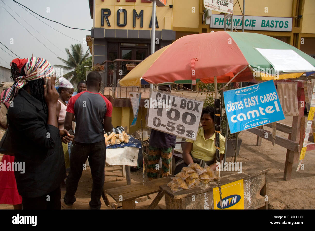 Street stall called a 'Call Box' selling mobile phone airtime credit and cards Yaound Cameroon West Africa - Stock Image