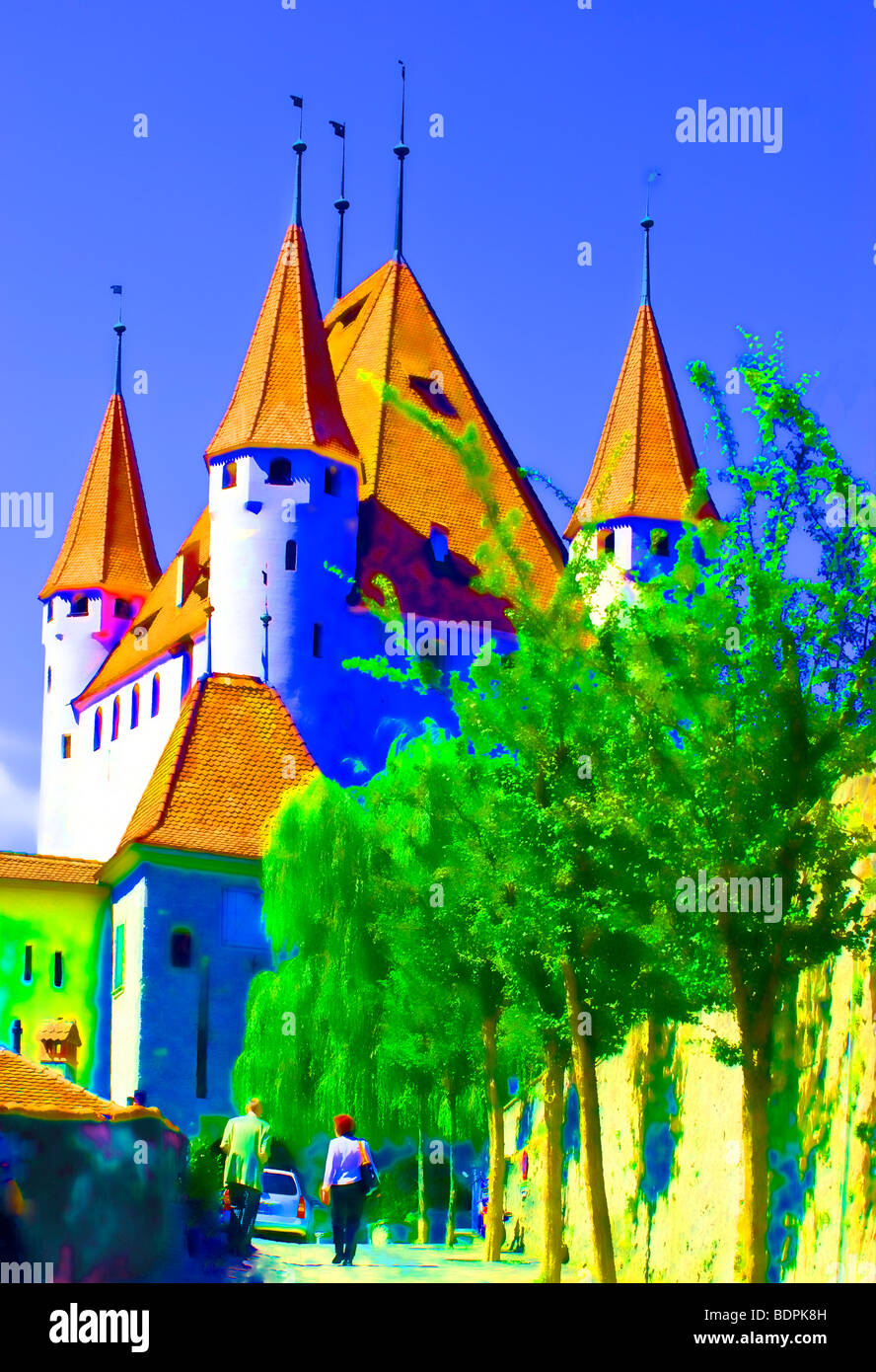 Picture, cartoon-like city of Thun - Switzerland. The towers of the ancient castle of Thun. - Stock Image