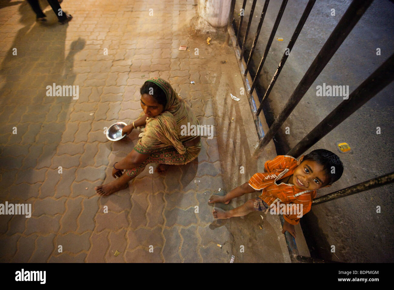 Homeless Mother and Boy Begging on the Street in Calcutta India Stock Photo