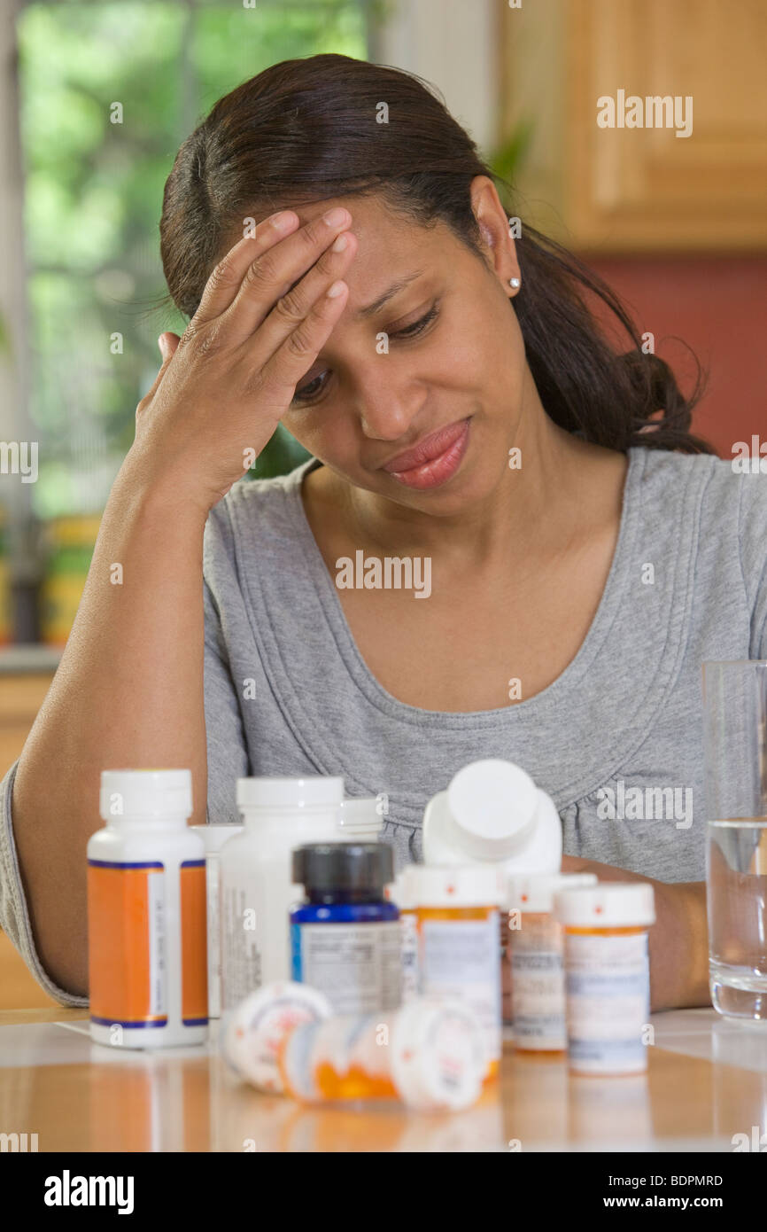 Hispanic woman suffering from a headache - Stock Image