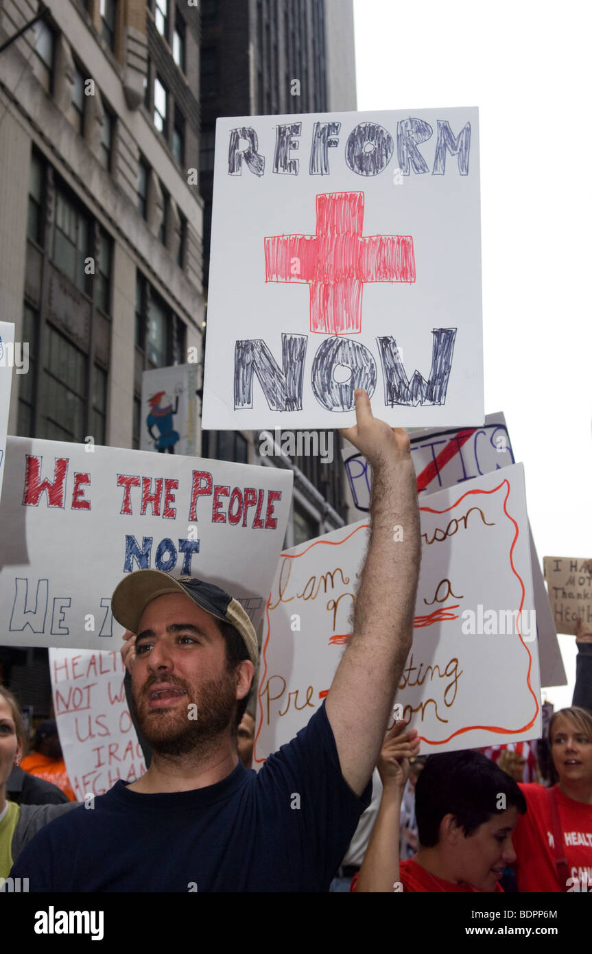 Thousands of supporters of health care reform gather in Times Square in New York - Stock Image