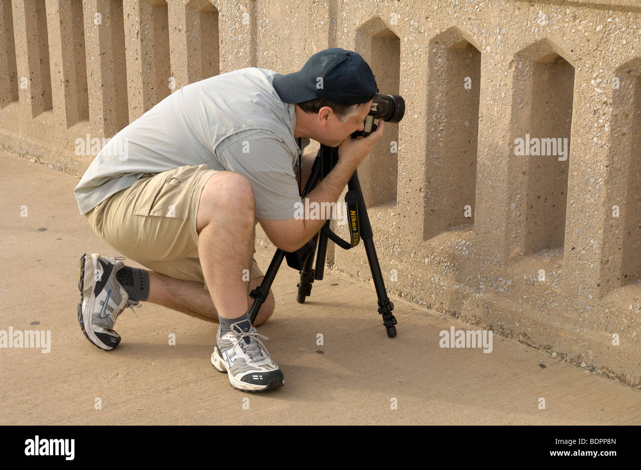 Professional photographer captures an interesting subject through a bridge rail.  Photo by Darrell Young. - Stock Image
