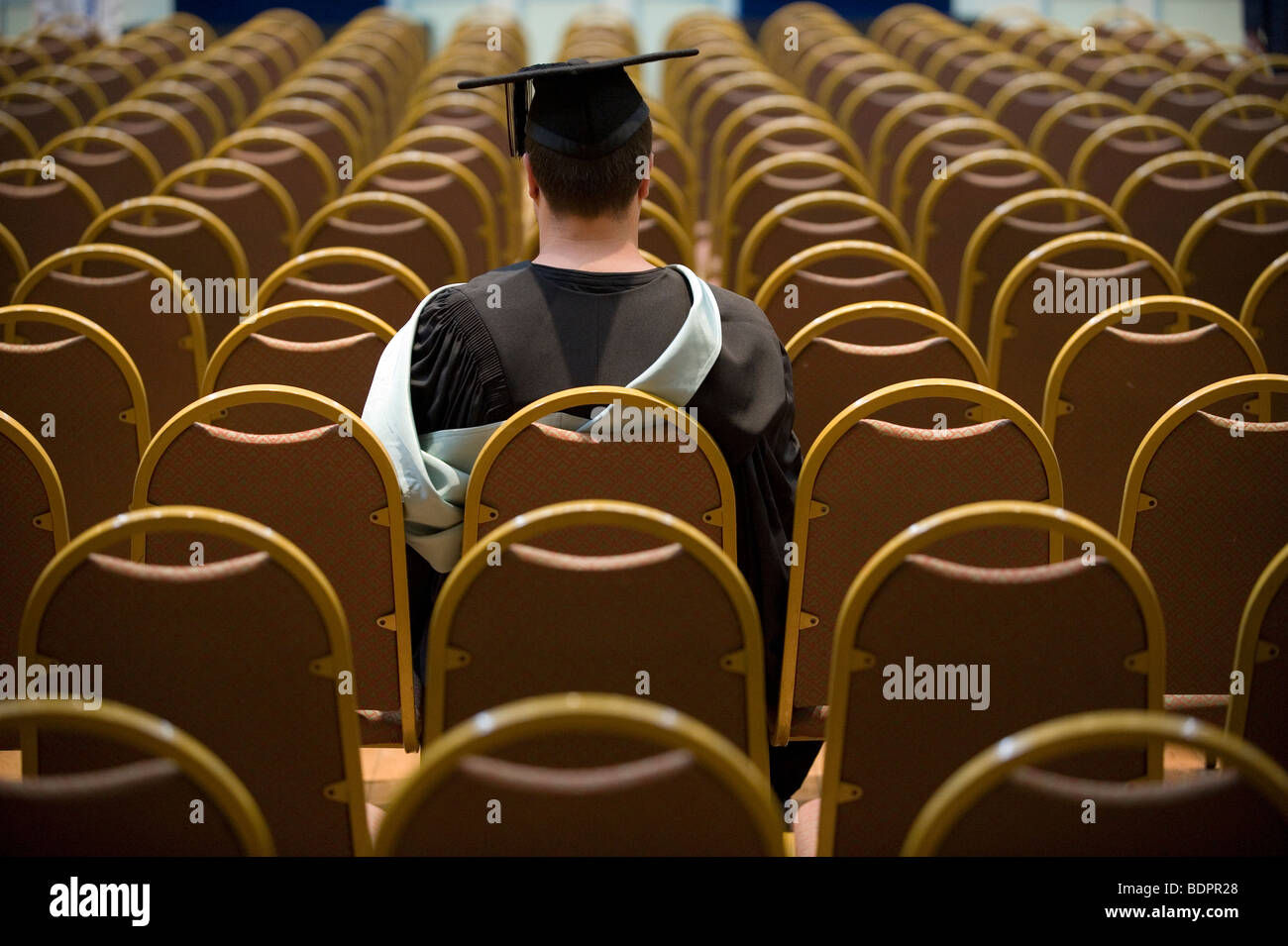 A university graduate waits for his ceremony to begin. - Stock Image