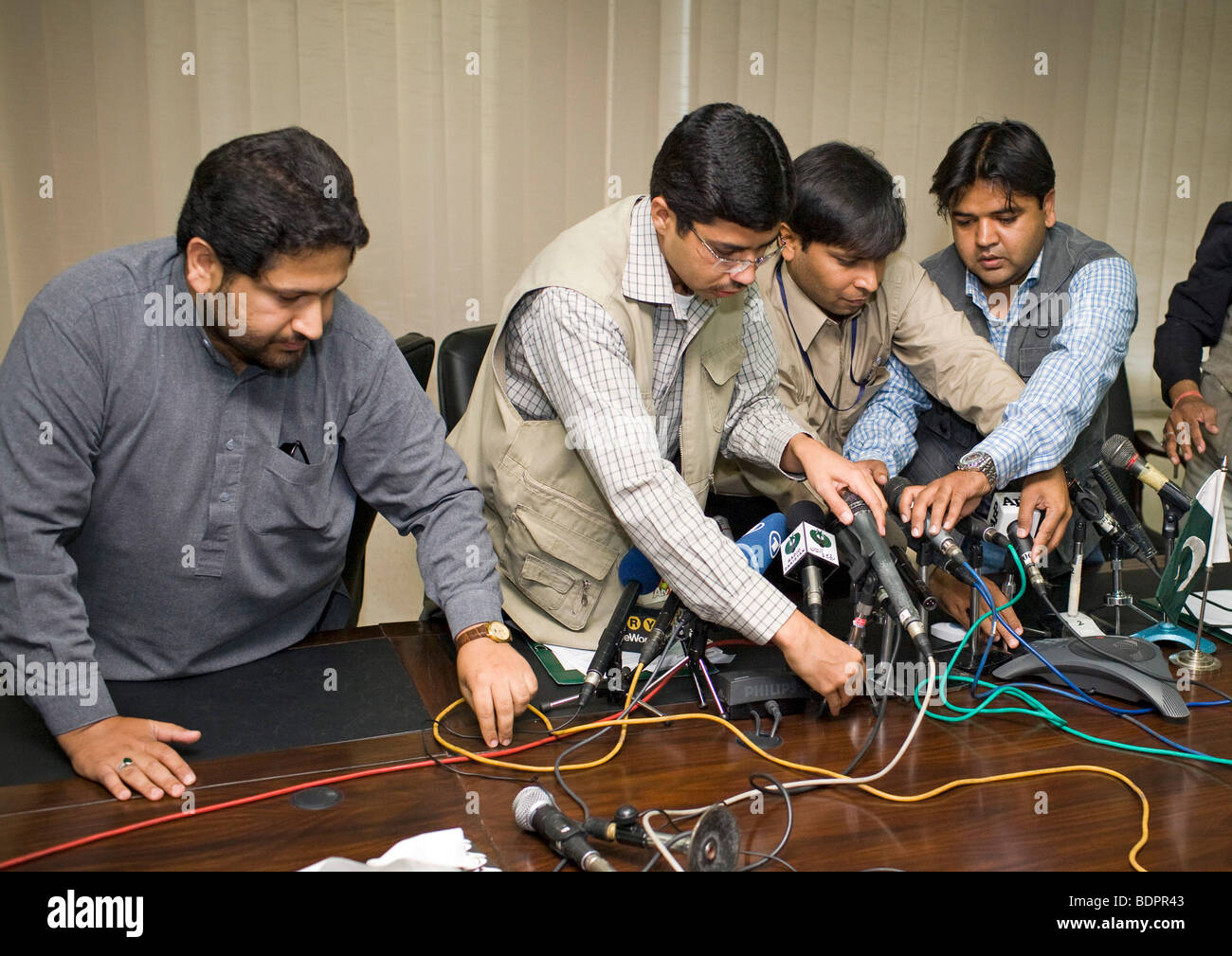 | Journalists preparing microphones - Stock Image