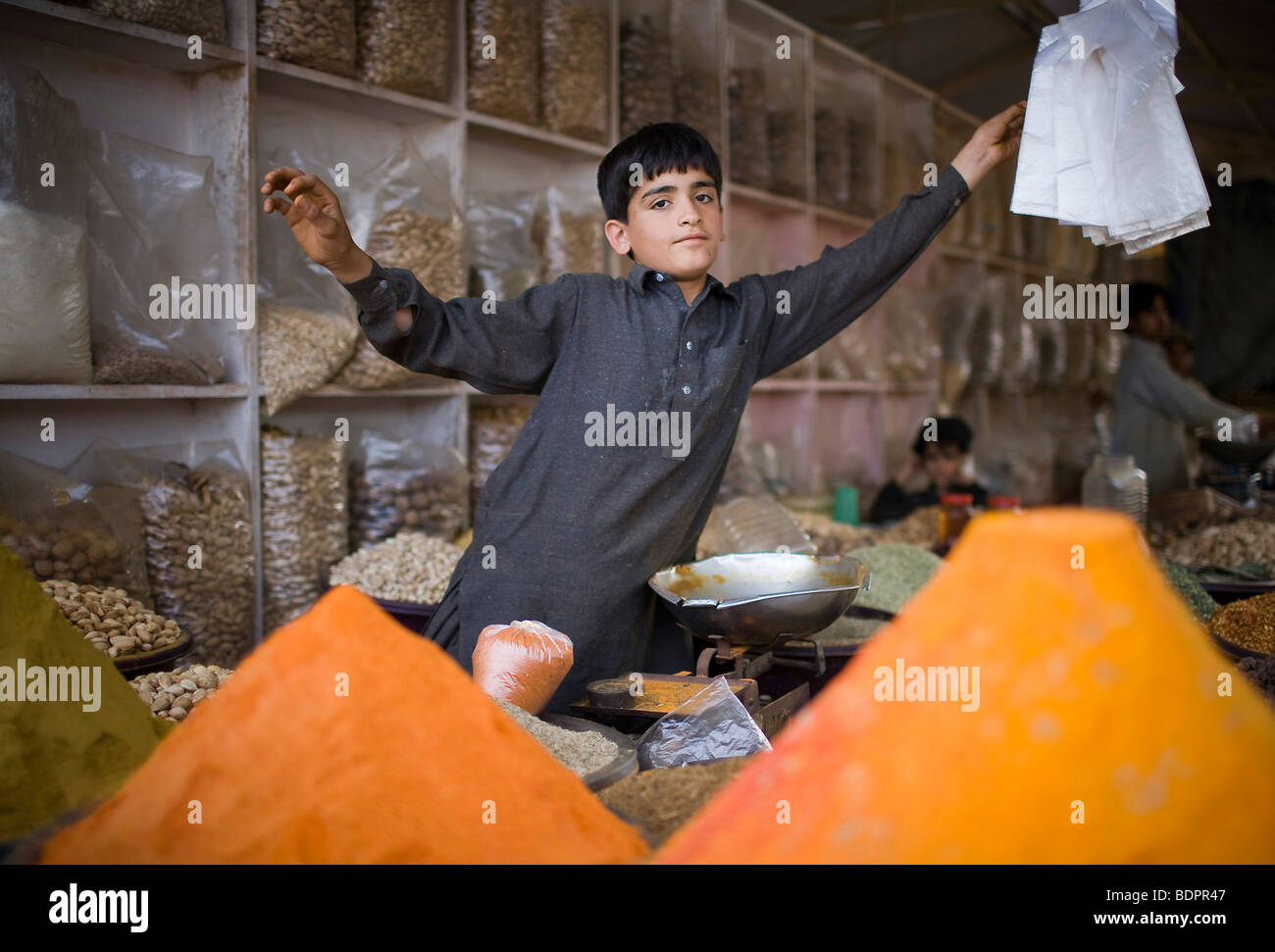 Child selling spices at the Itwar Bazar in Islamabad Stock Photo
