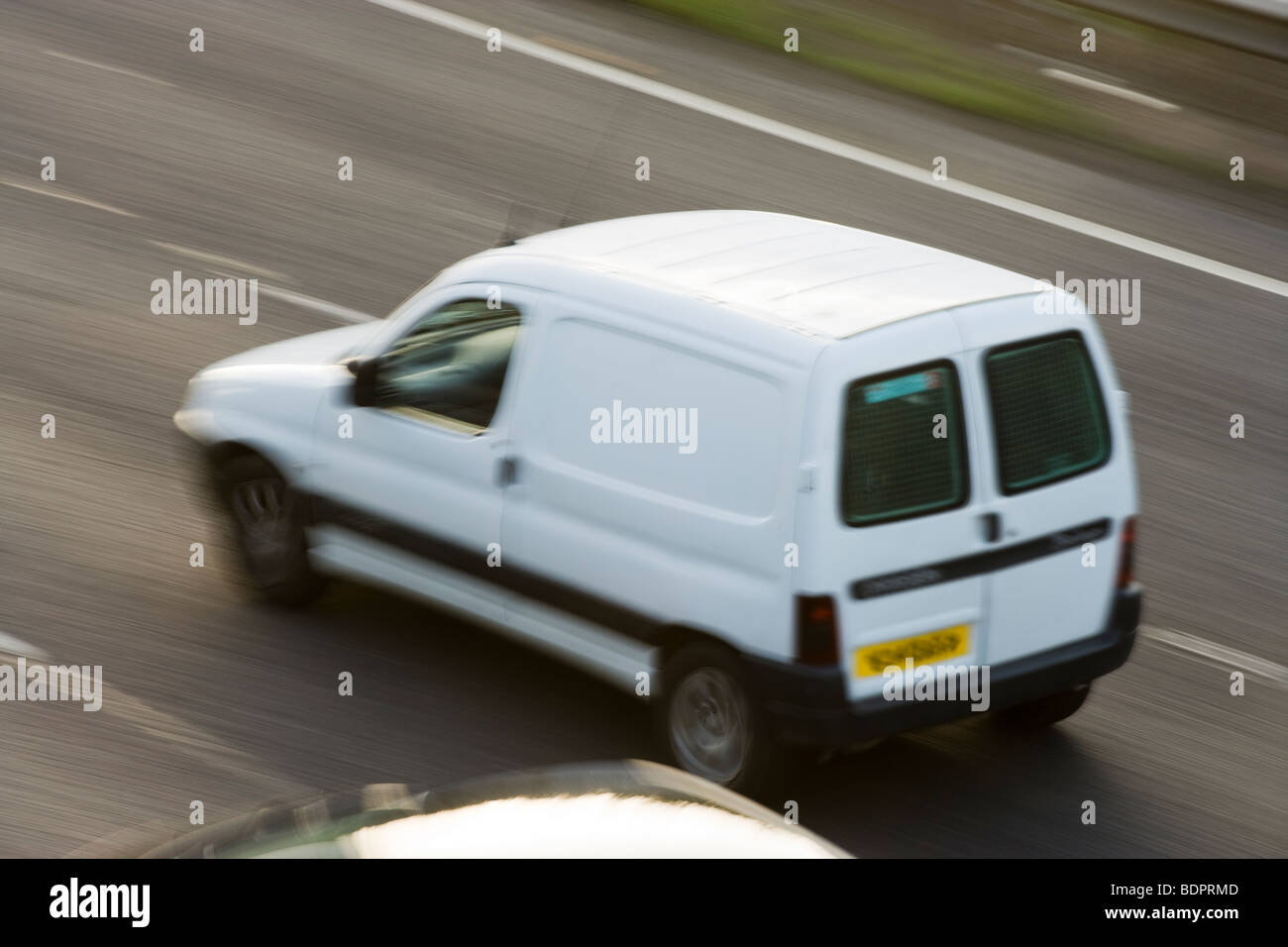 White van on motorway. UK - Stock Image