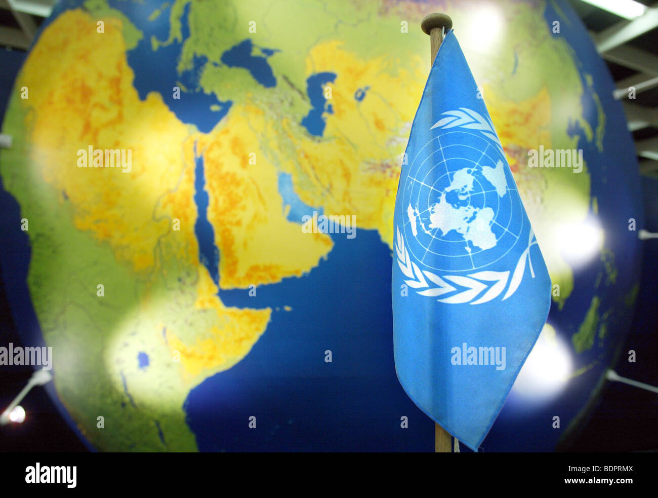 UN-flag in front of a globe . Cologne , - Stock Image