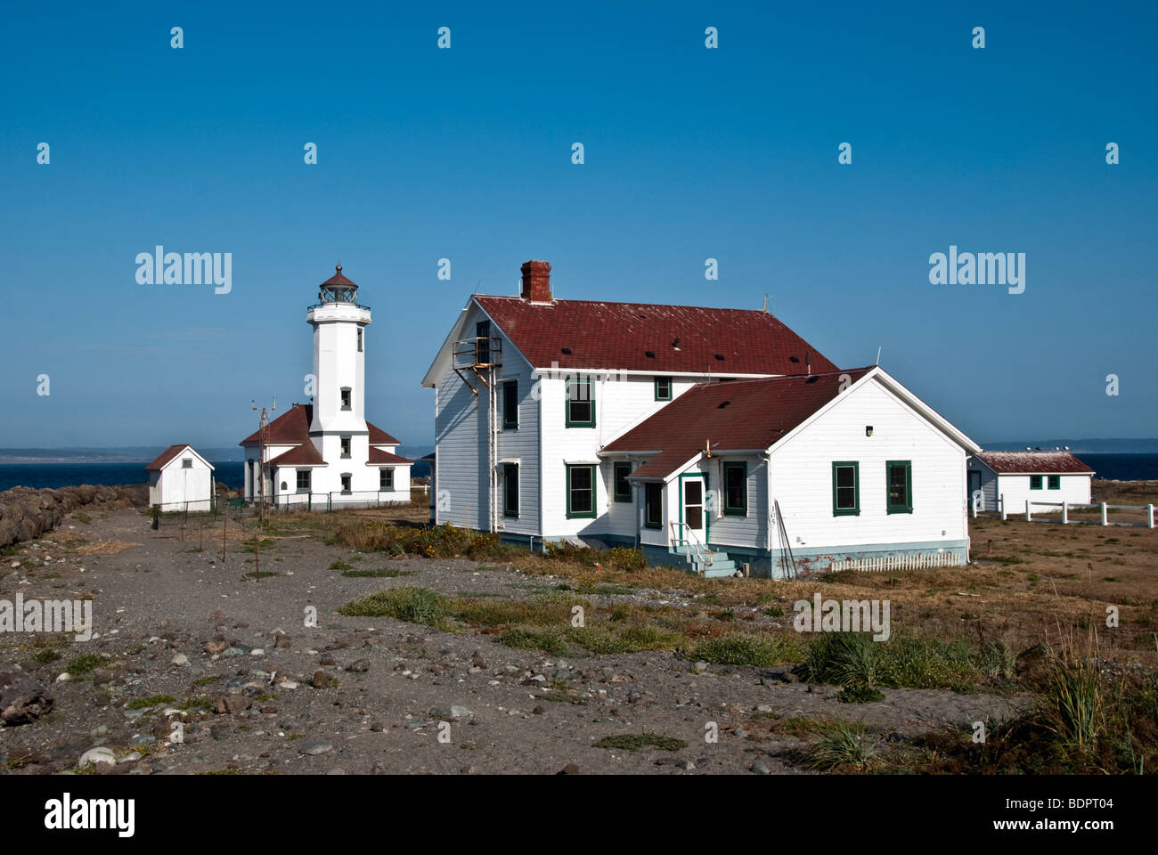 automated unoccupied Point Wilson Lighthouse & keepers dwelling guarding the entrance to Puget Sound Port Townsend - Stock Image