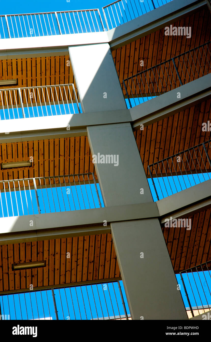 Highrise walkway to flats with blue sky - Stock Image