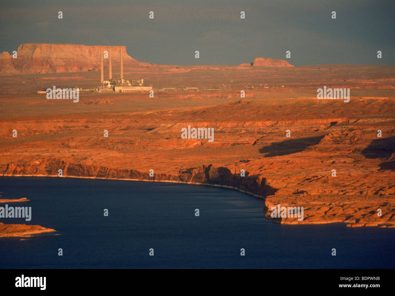 Sunset over Lake Powell, power plant in background - Stock Image