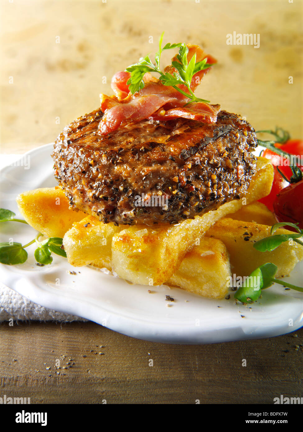 Peppered beef burger with chips - Stock Image