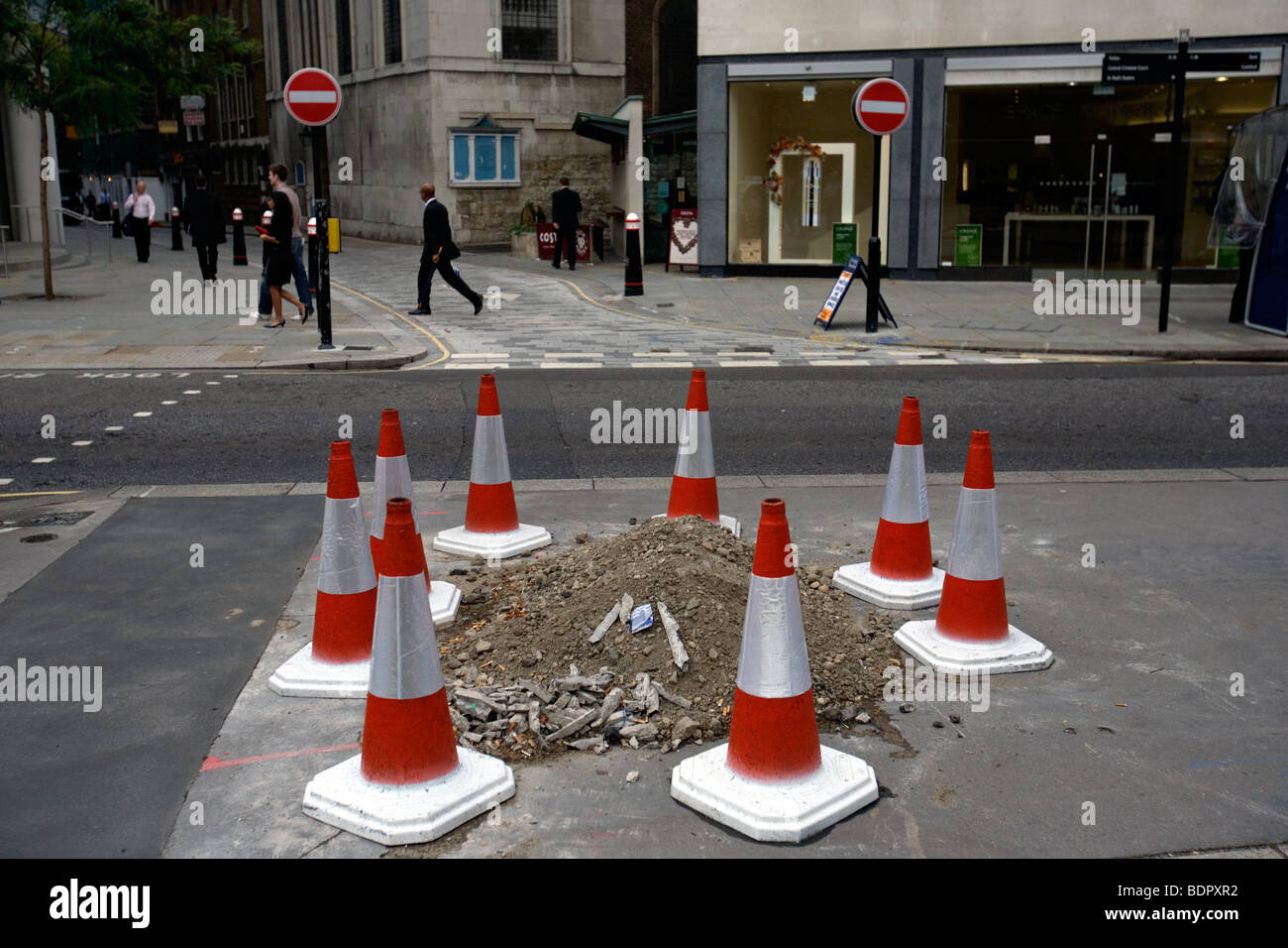 traffic cones on the pavement in the city of london - Stock Image