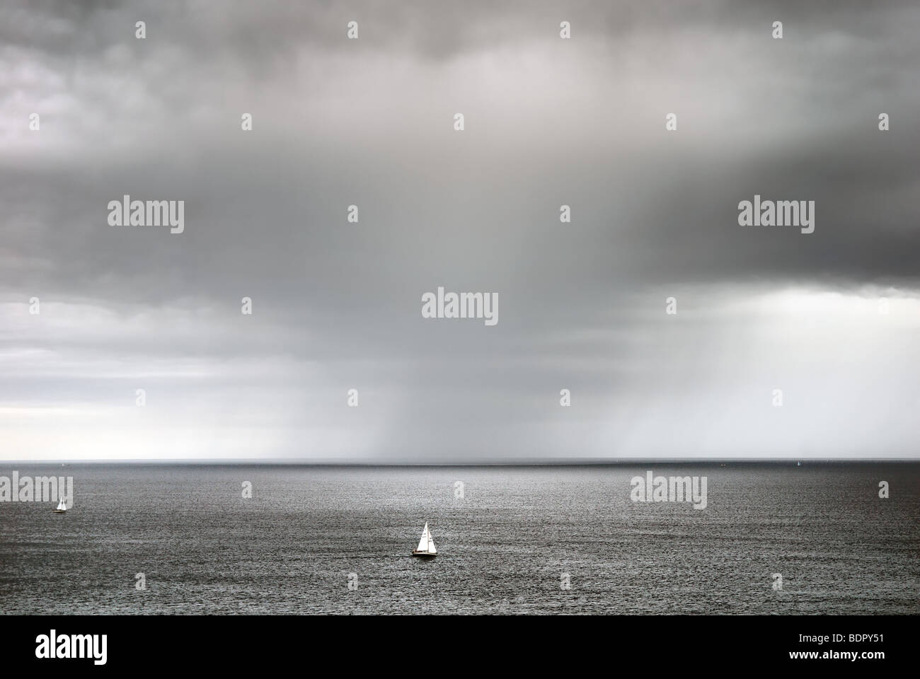 Approaching storm at sea with yachts Dorset coast - Stock Image