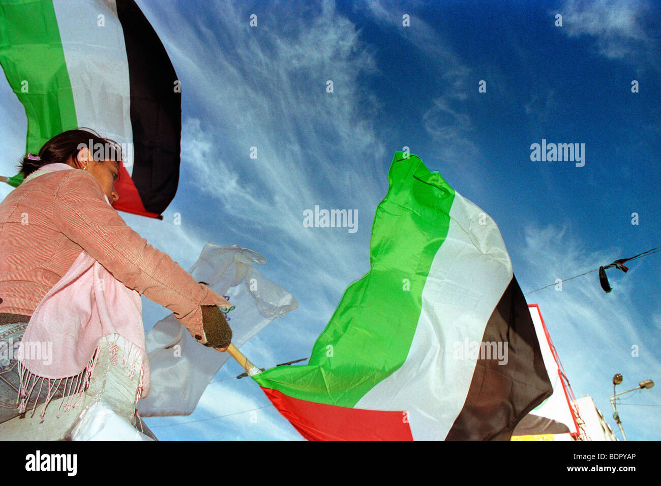 Palestinian flag hold by a girl on a manifestation in Ramallah, during a celebration - Stock Image