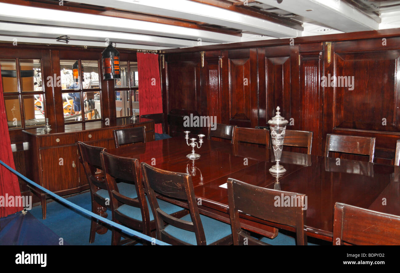 The Captain's dining area onboard the HMS Victory, Nelson's flagship in Portsmouth Historic Dockyard, Hampshire, - Stock Image