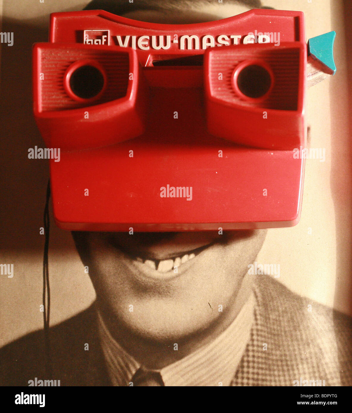 A smiling mans face behind a view master Stock Photo