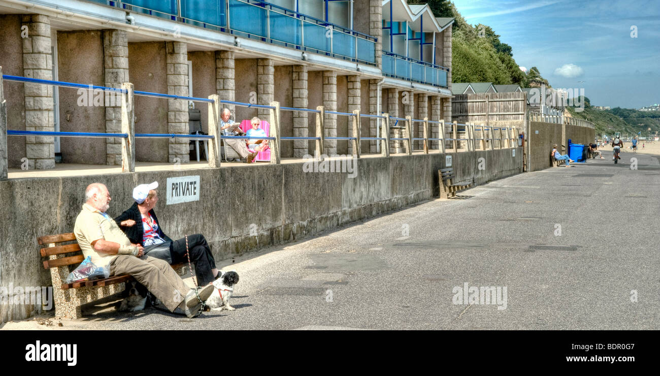 Old people sitting on the sea front - Stock Image