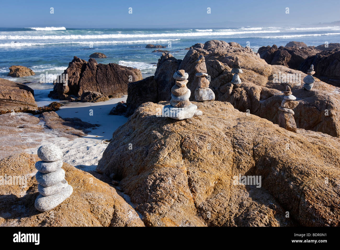 Rock markers and ocean on 17 Mile Drive. Pebble Beach, California - Stock Image