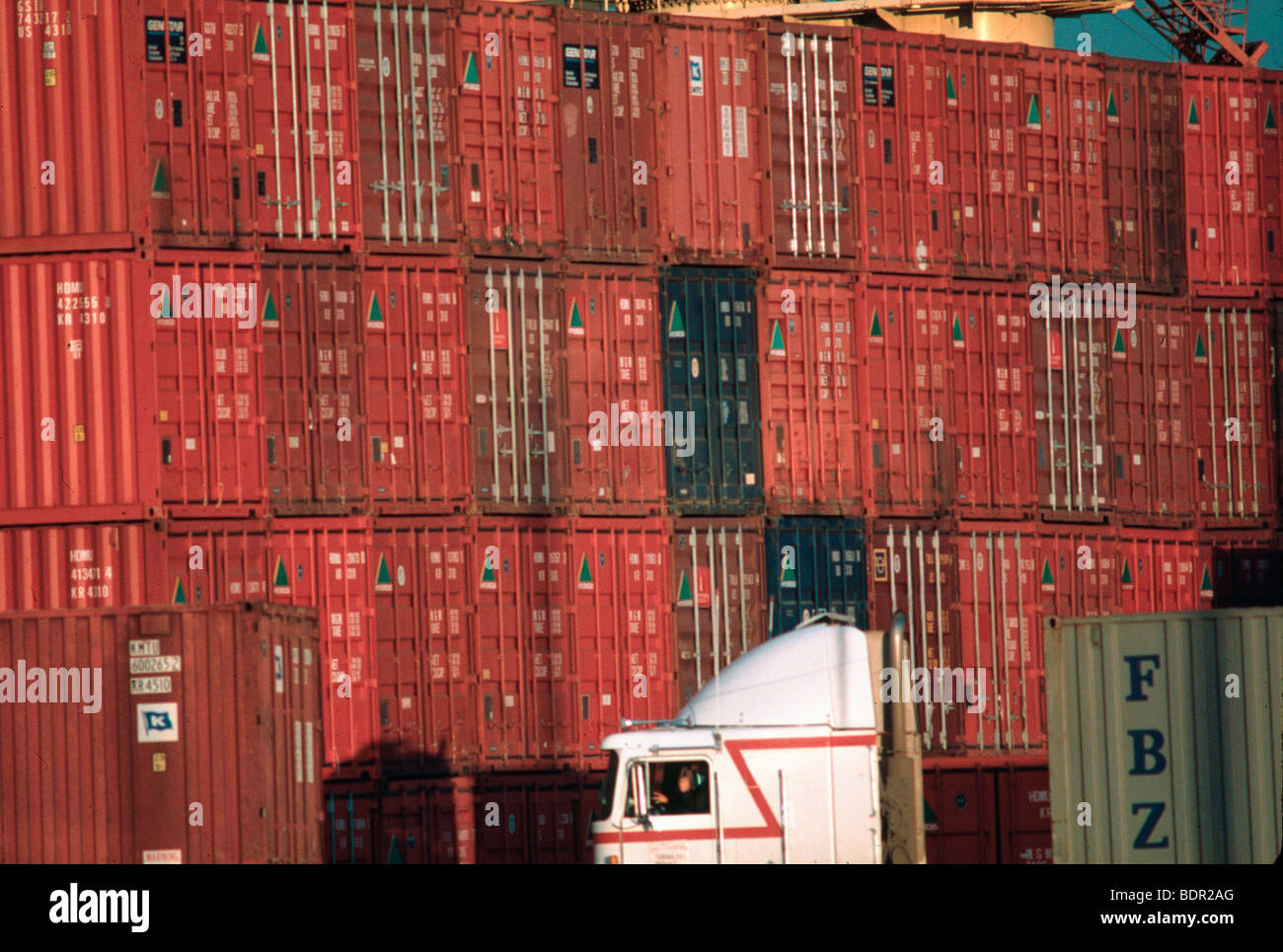 Shipping containers and truck at Port of Seattle - Stock Image