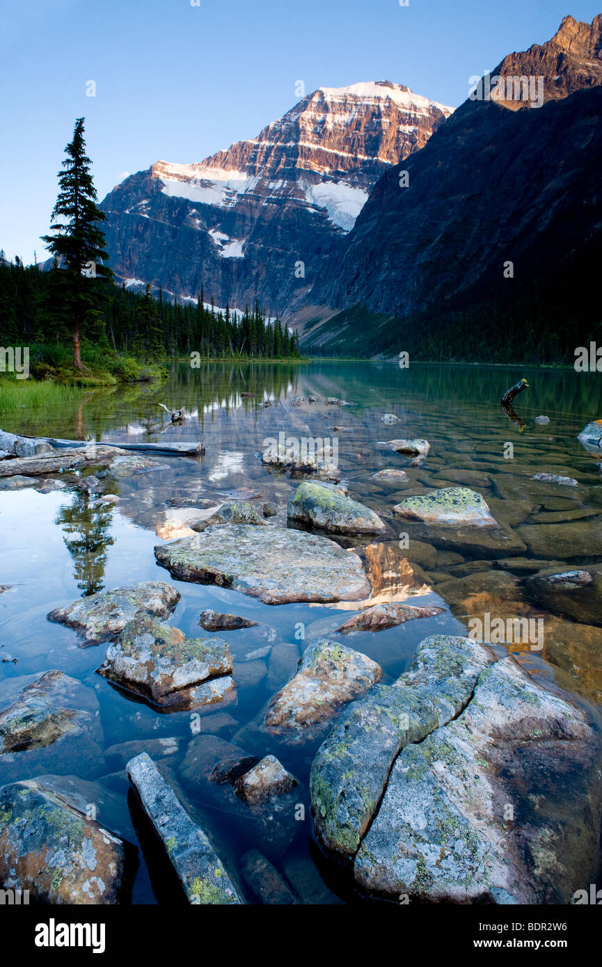 Sunset over Mount Edith Cavell and Cavell Lake, Jasper National Park, Alberta, Canada - Stock Image