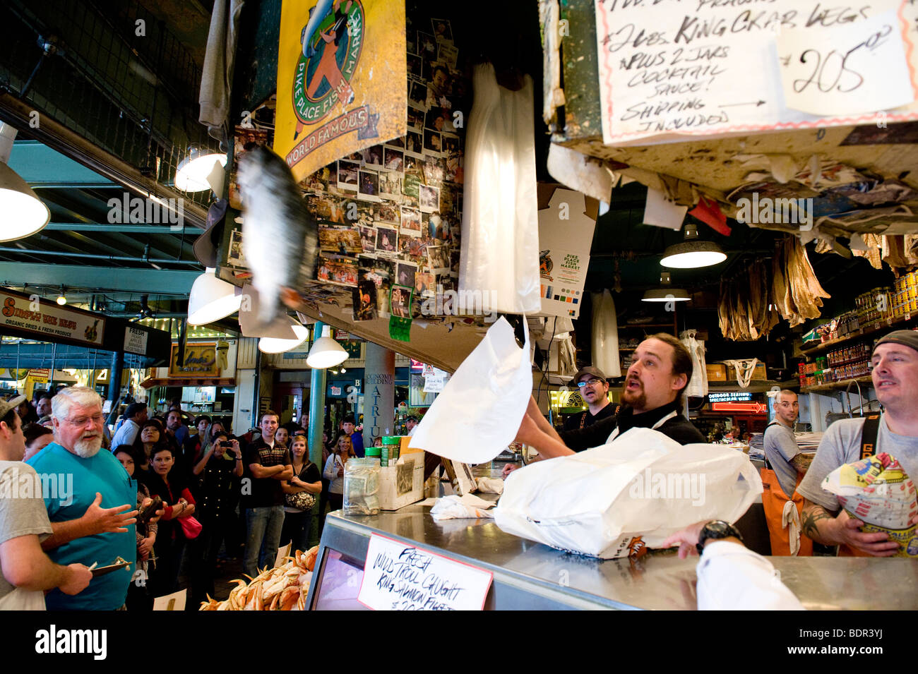 Fishmonger tossing fish at Pike Place Market, Seattle, Washington, USA Stock Photo