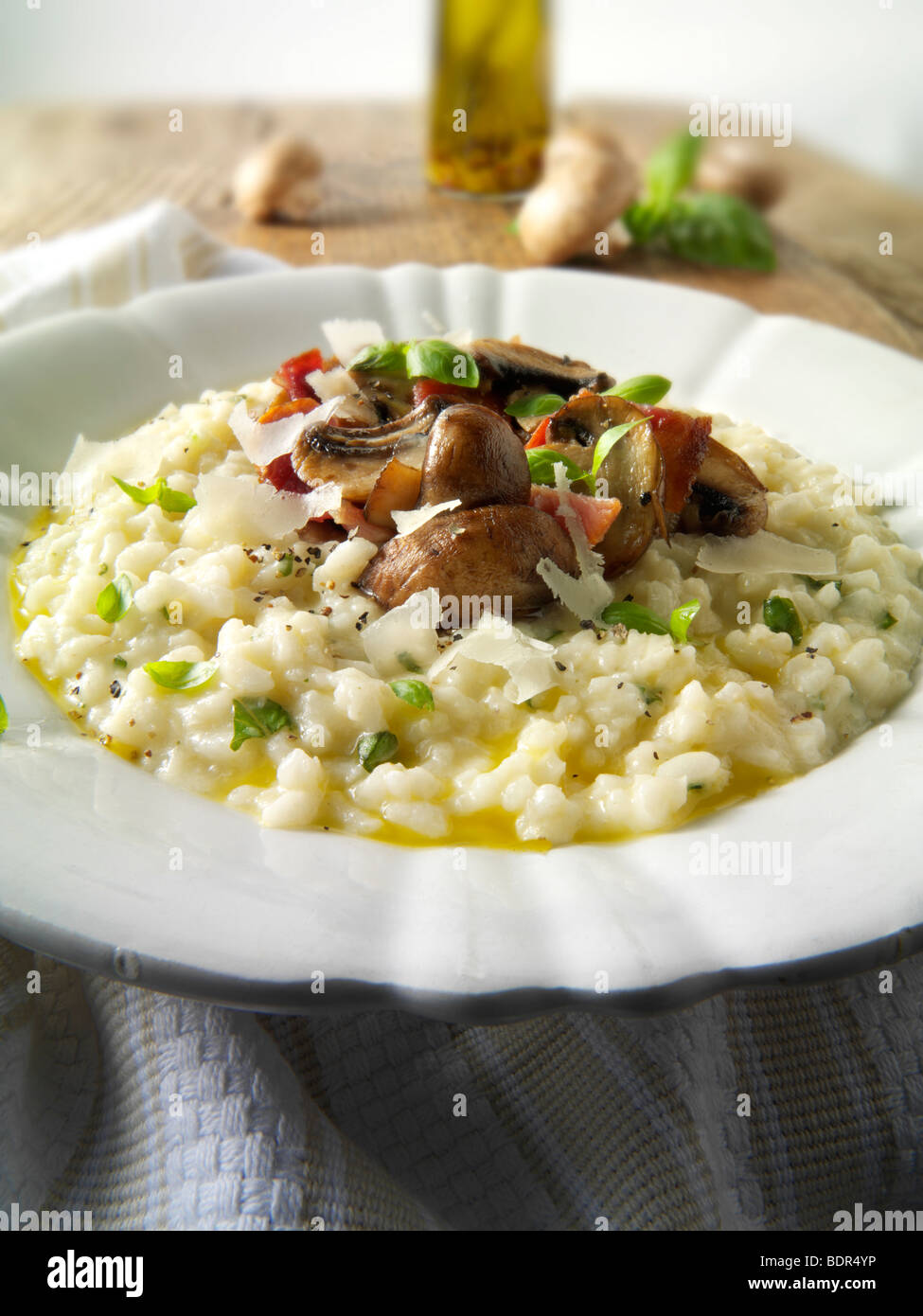 Classic risotto with wild porcini mushrooms and bacon - Stock Image