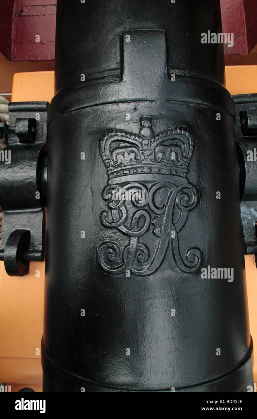 Close up of the Royal Crest engraving on a cannon on HMS Victory in Portsmouth Historic Dockyard, Hampshire, UK. Stock Photo
