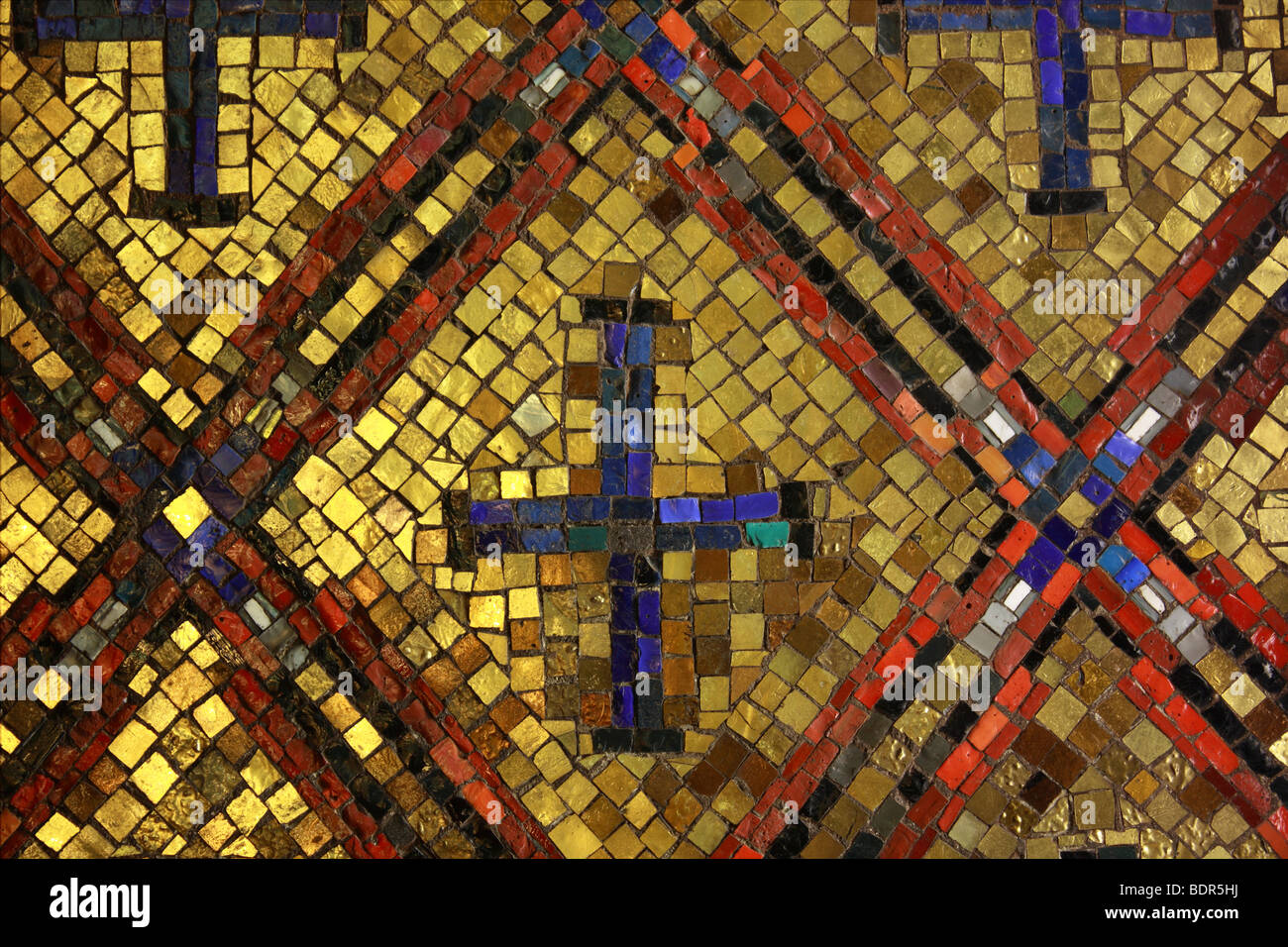 Old Byzantine style glass with gold mosaic tiles - Stock Image