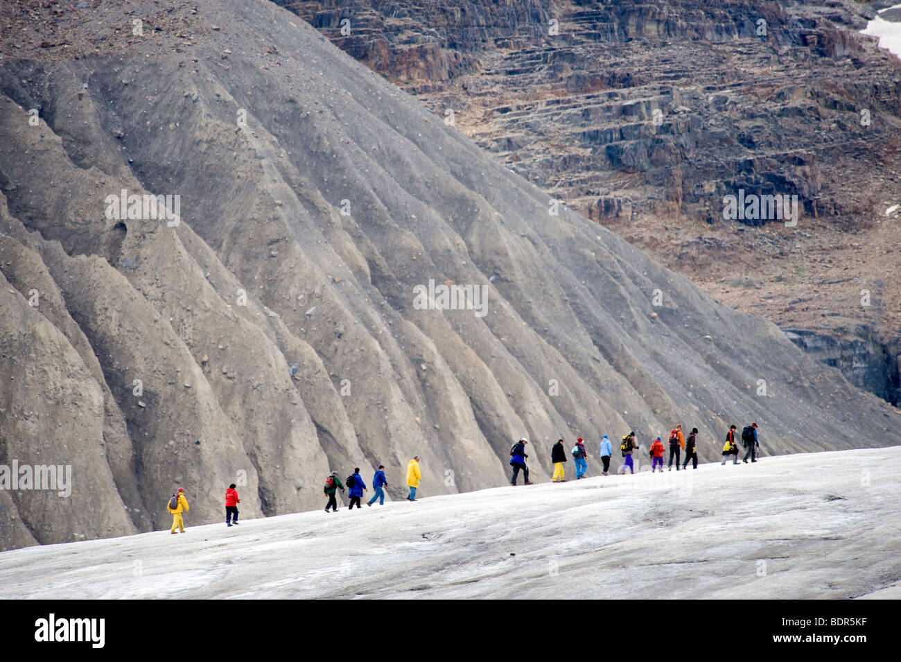 Tourist on a guided walk on the Athabasca Glacier, Jasper National Park, Alberta, Canada - Stock Image