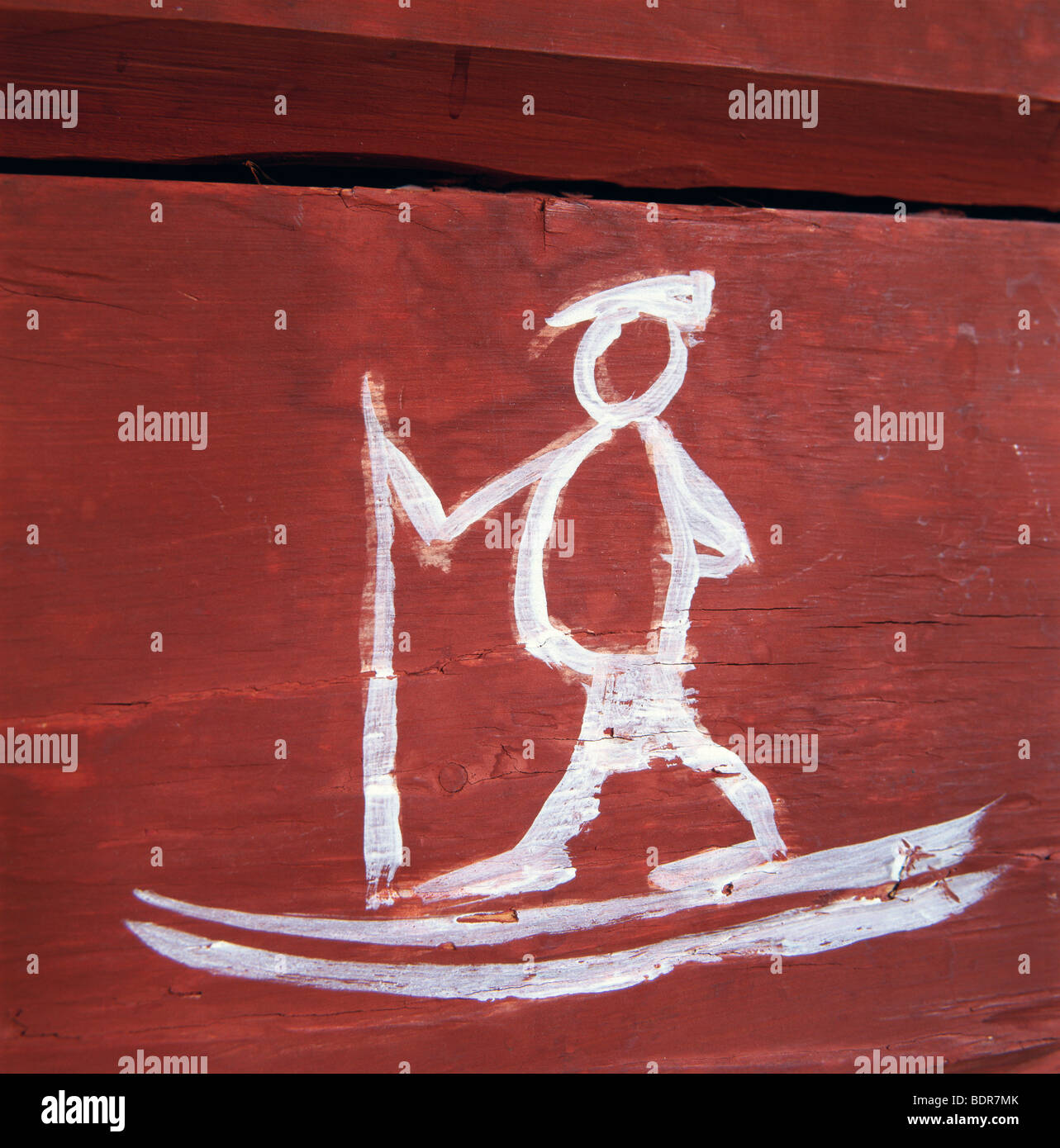 Painted skier on a wall, Sweden. - Stock Image