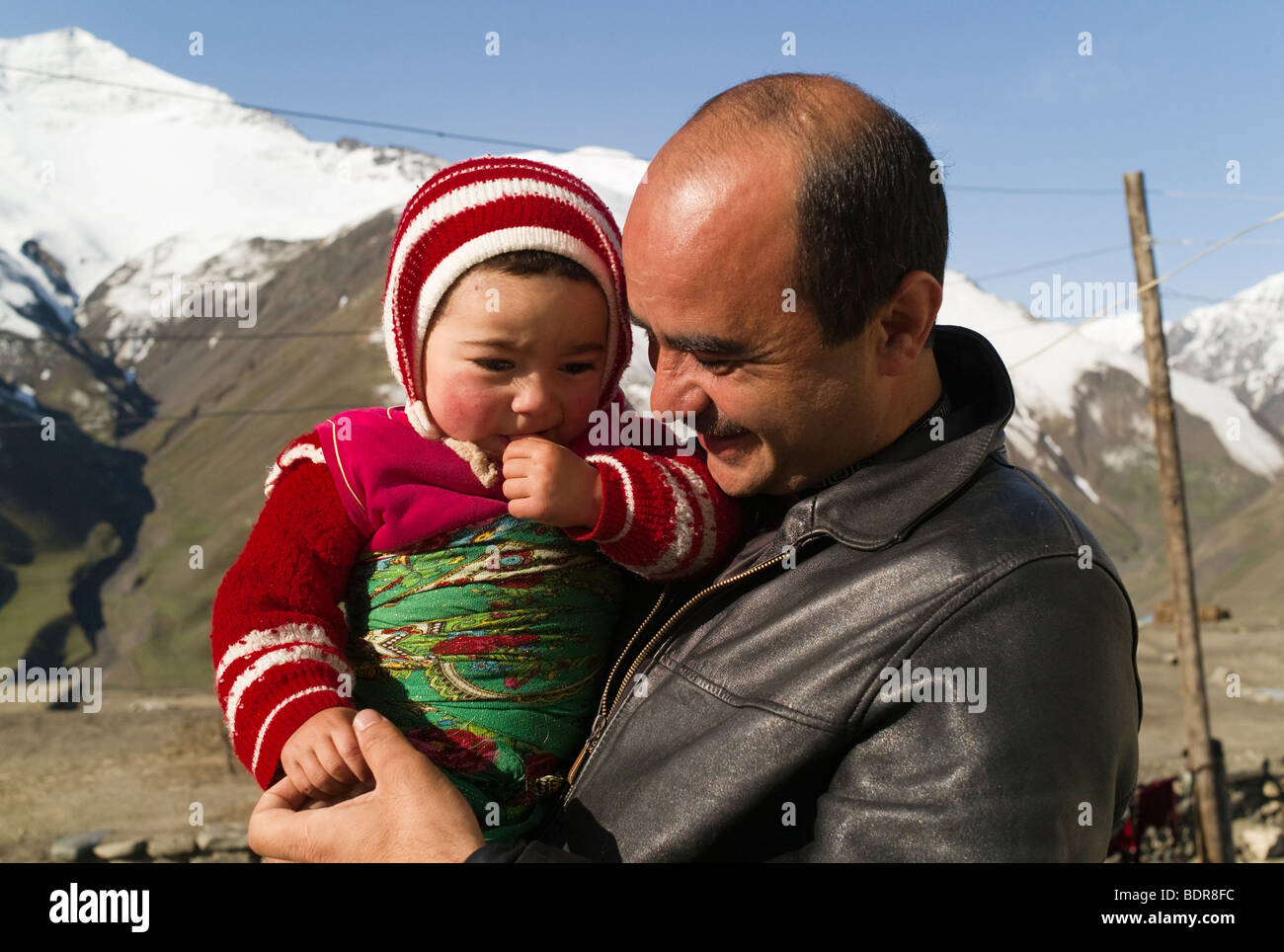 Father and child from the Caucasian mountains in Azerbaijan. Photo taken in Xinaliq, a little, beautiful village. - Stock Image