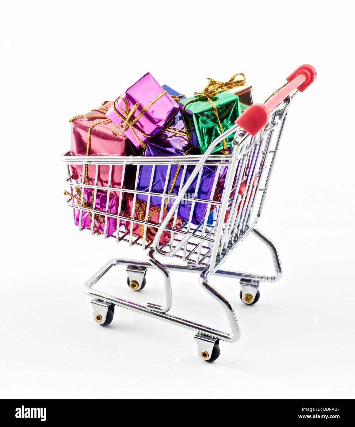 shopping cart with presents isolated on white - Stock Image