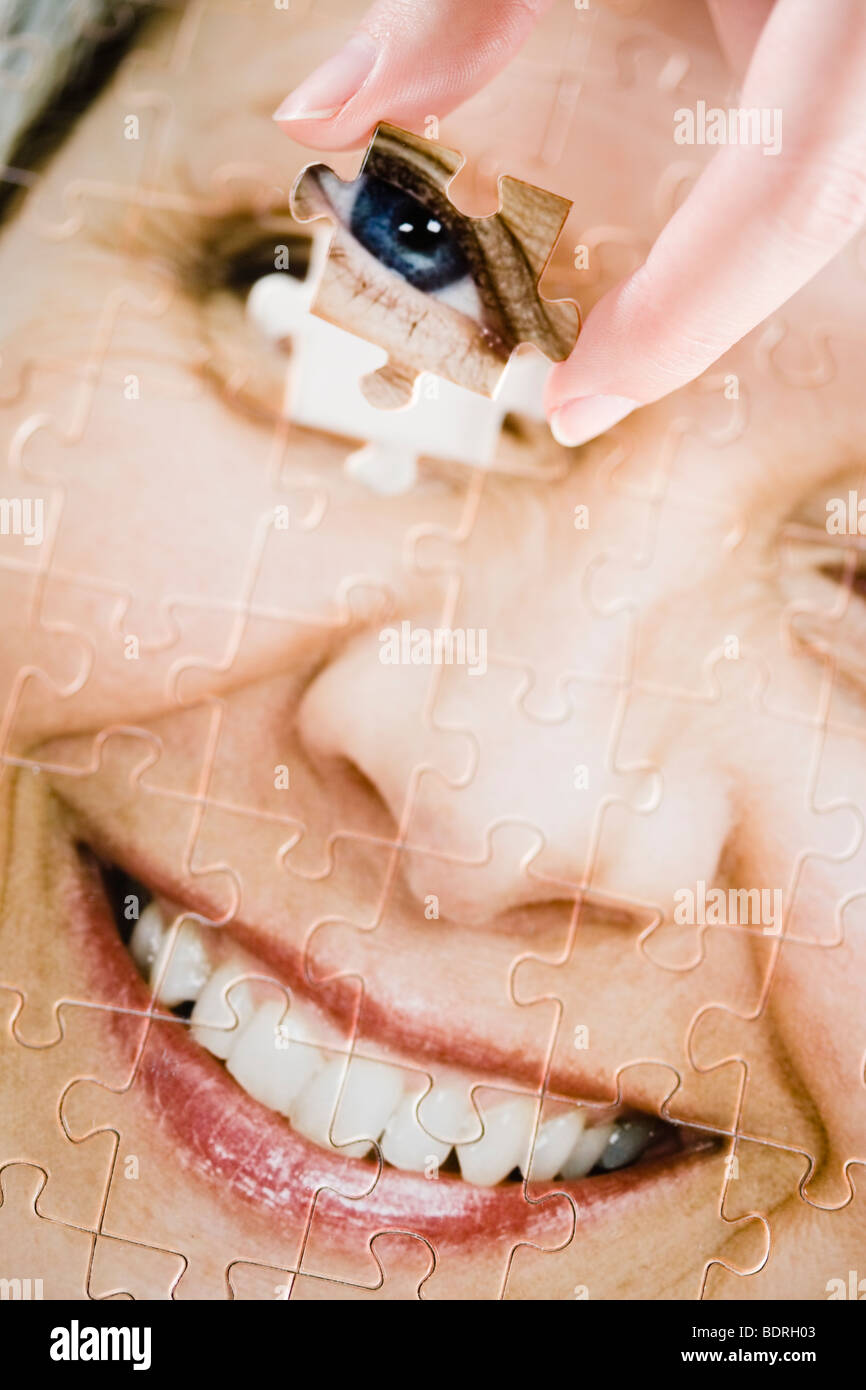 A puzzle with the image of a woman. - Stock Image
