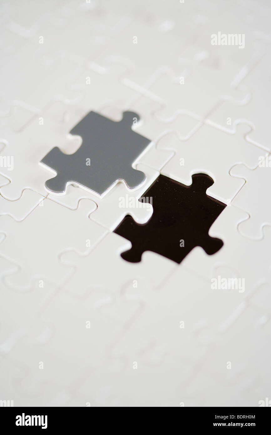 A puzzle with a missing piece. - Stock Image