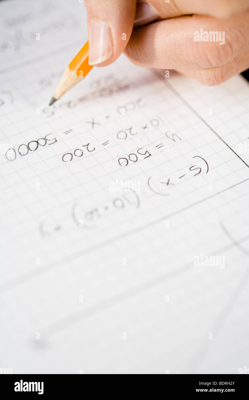 A woman calculating close-up. - Stock Image