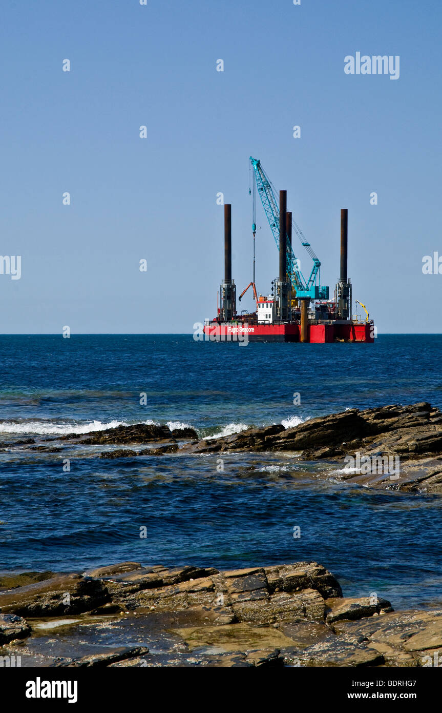 dh Wave Power ELECTRICITY UK Fugro Seacore platform positioning test rig off shore Billia Croo Orkney - Stock Image
