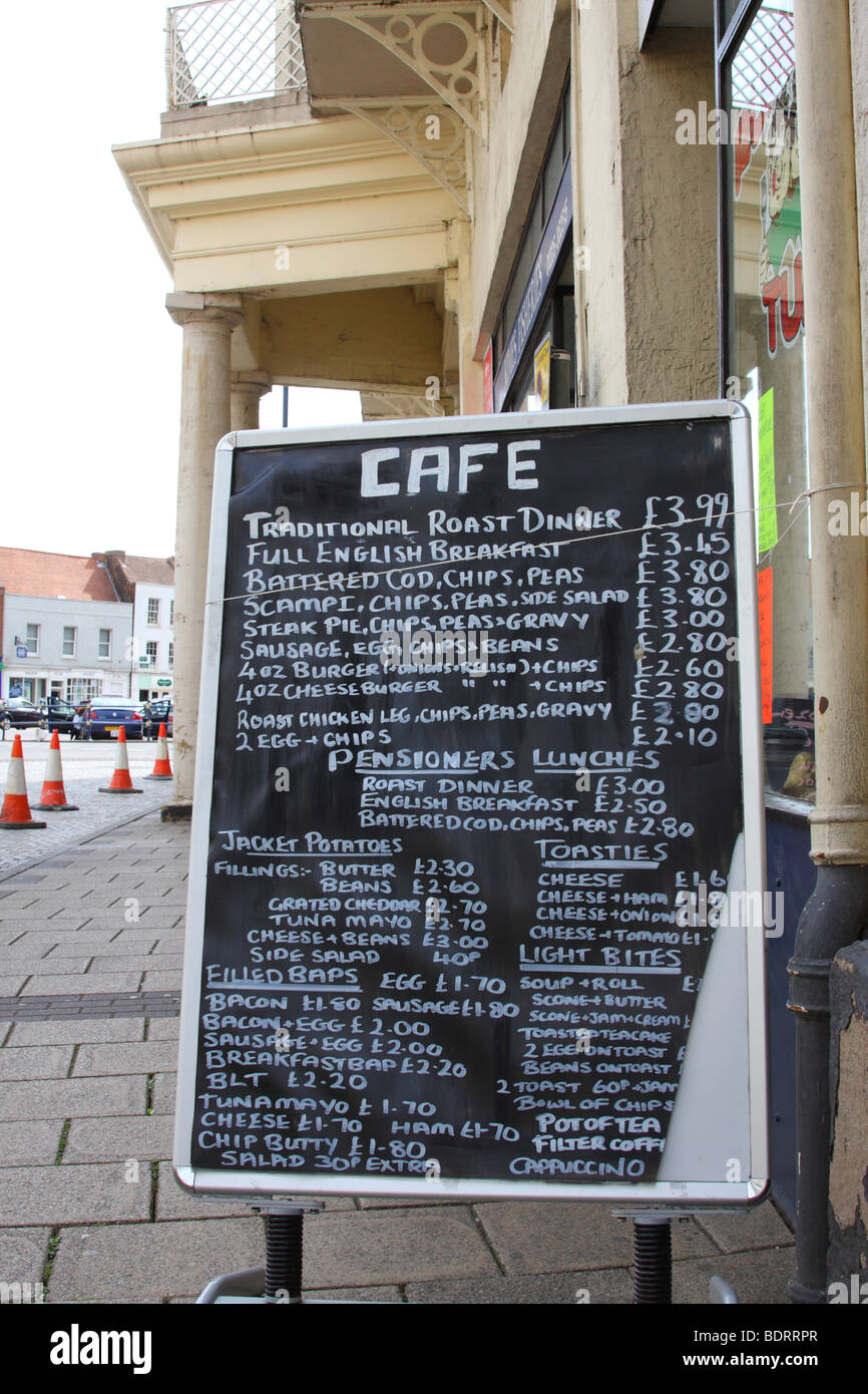 A cafe menu obstructing the pavement in a U.K. town. - Stock Image