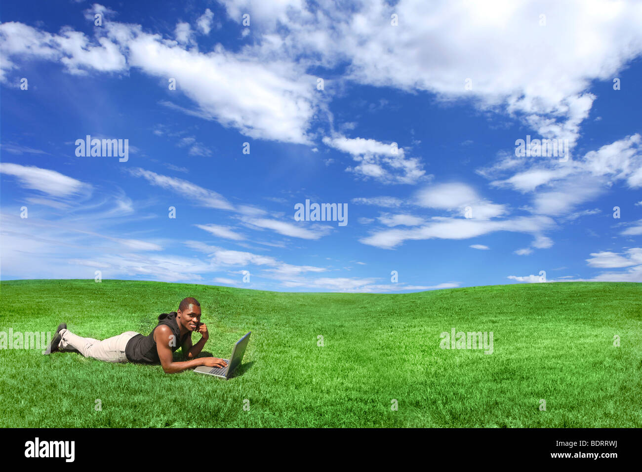 Student Working Outdoors on a Laptop Computers - Stock Image