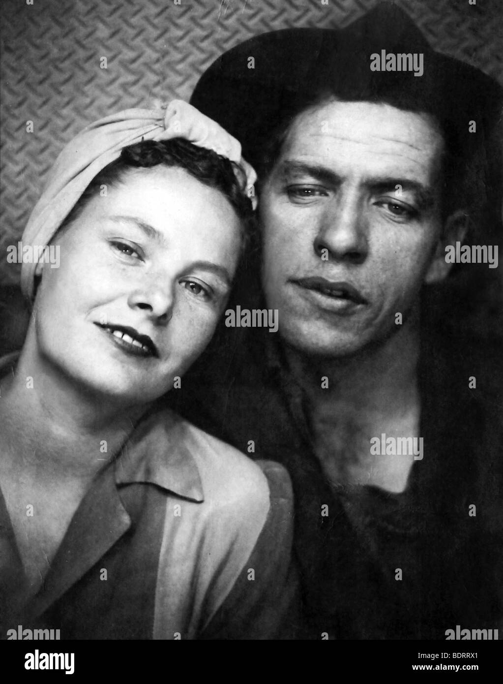 Genuine 1940 Era Factory Worker Couple Portrait. Some Original Print Damage Visible. - Stock Image