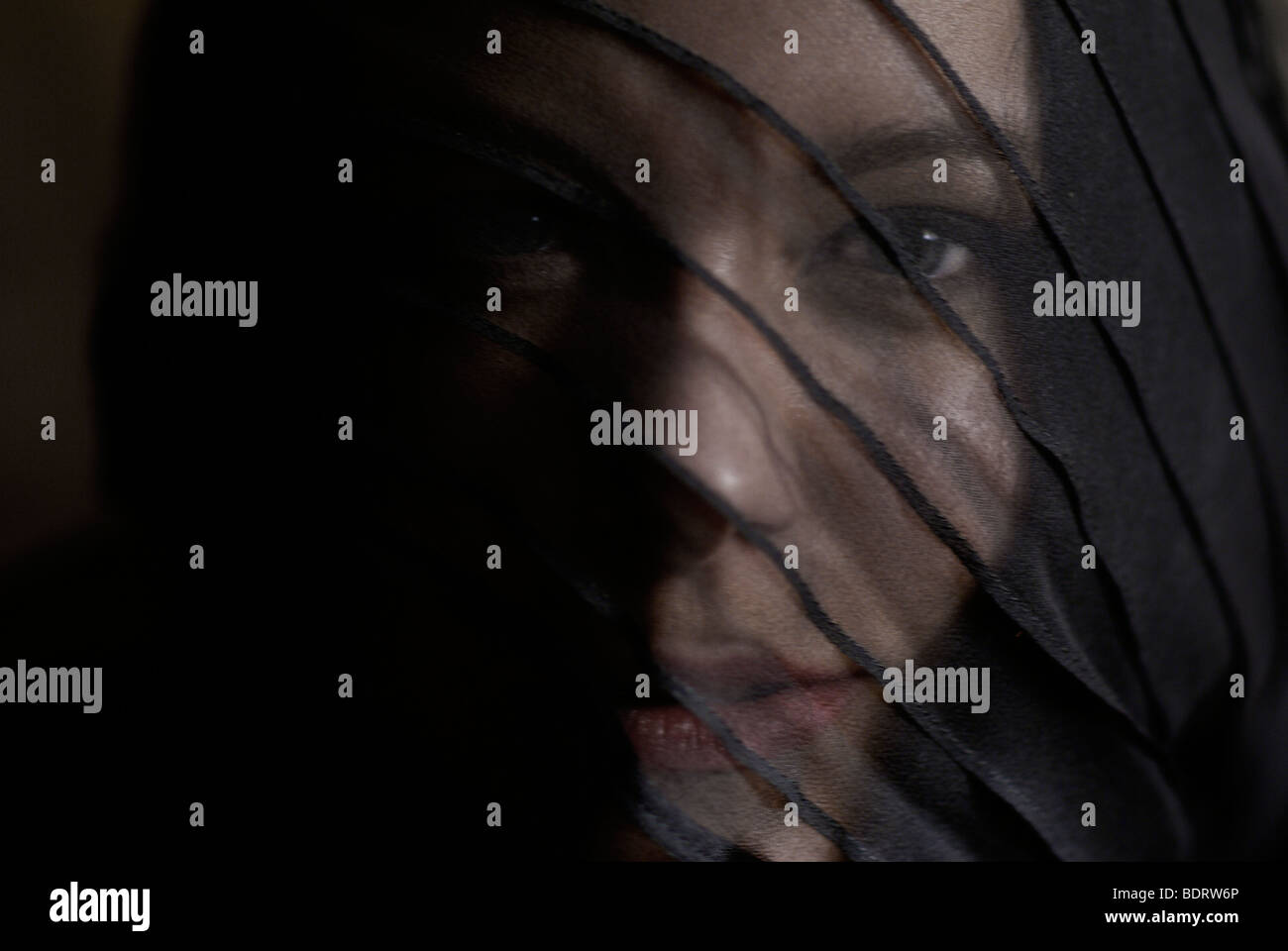 Young woman wearing black and a veil, portrait - Stock Image