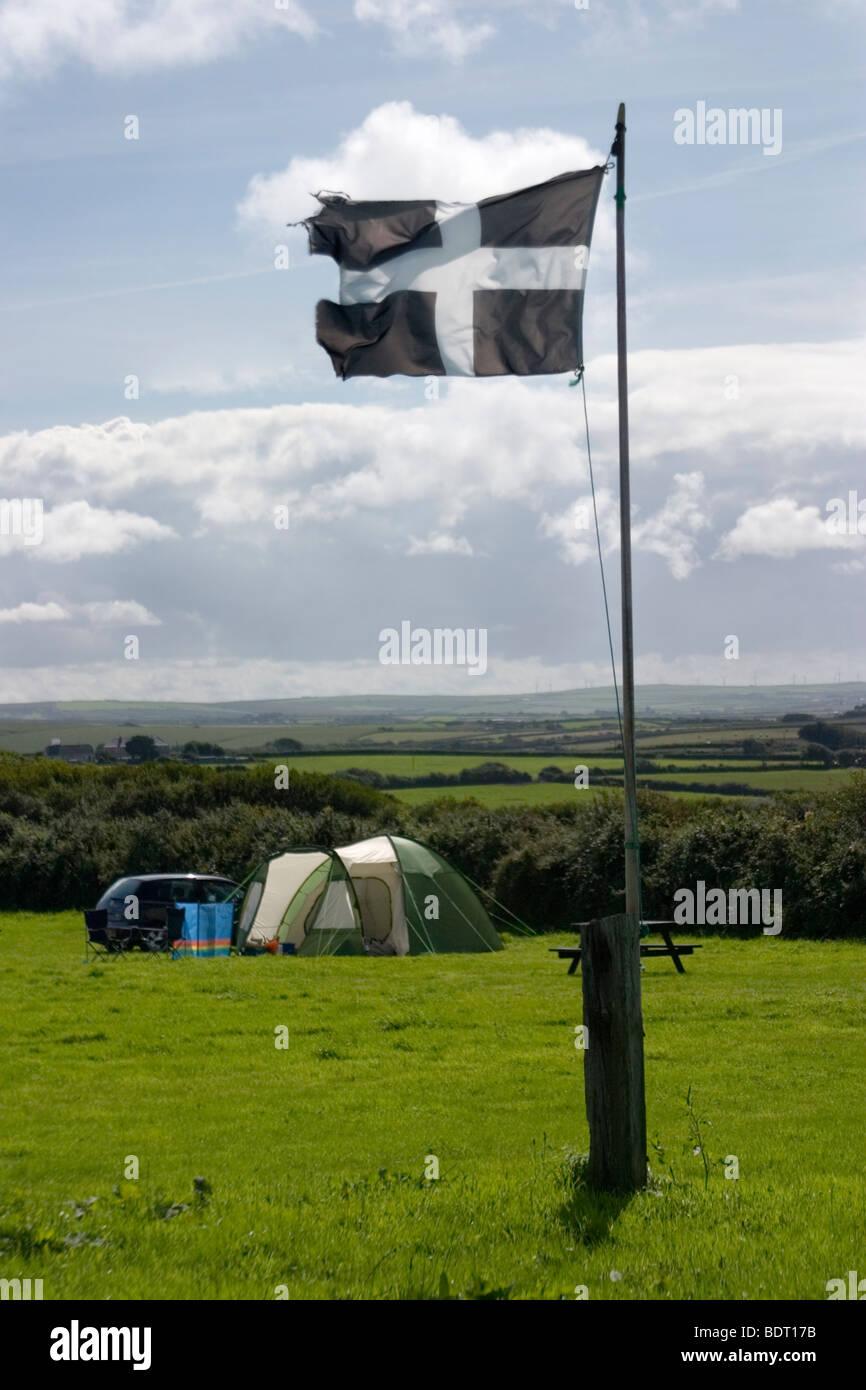 Cornish flag flying on campsite, Cornwall, UK - Stock Image