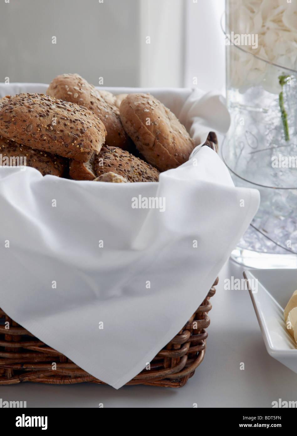 bread rolls in basket - Stock Image