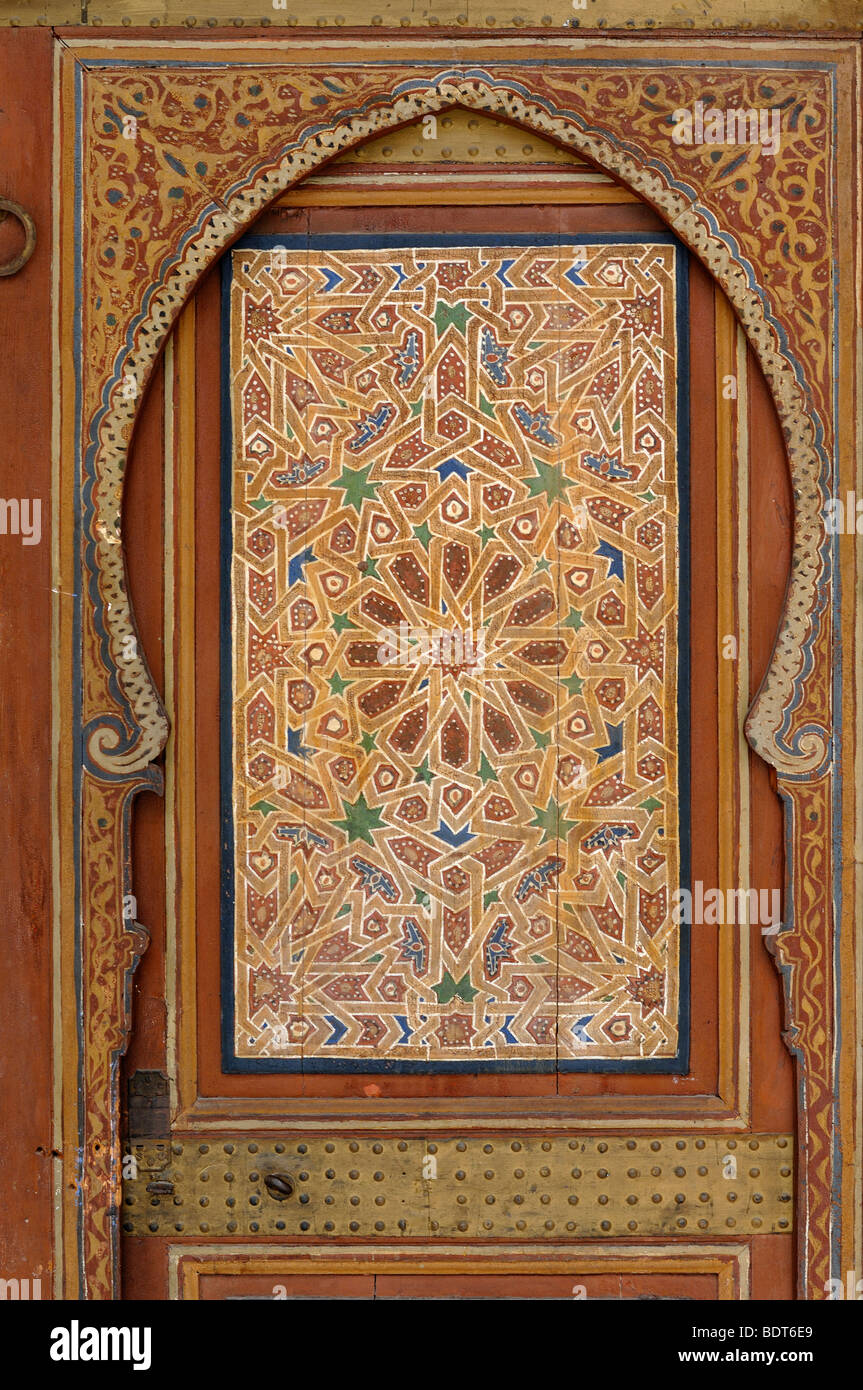Decorative c19th Painted Inlaid Woodwork on a Timber, Wood or Wooden Door at the Bahia Palace Marrakesh Morocco - Stock Image